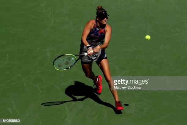 Marketa Vondrousova of the Czech Republic returns a shot to Svetlana Kuznetsova of Russia on Day Three of the 2017 US Open at the USTA Billie Jean...