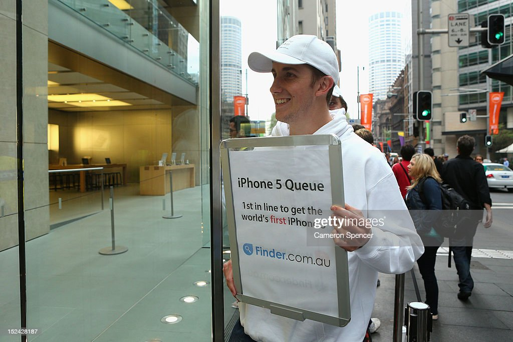 A marketer promotes a brand in the queue the iPhone 5 at the Apple flagship store on George street on September 21, 2012 in Sydney, Australia. Australian Apple stores are the first in the world to receive and sell the new iPhone 5 handsets.