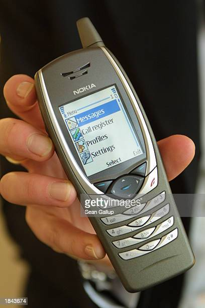A marketing assistant holds the new Nokia 6650 UMTS capable mobile phone at the CeBIT technology trade fair March 12 2003 in Hanover Germany CeBIT...