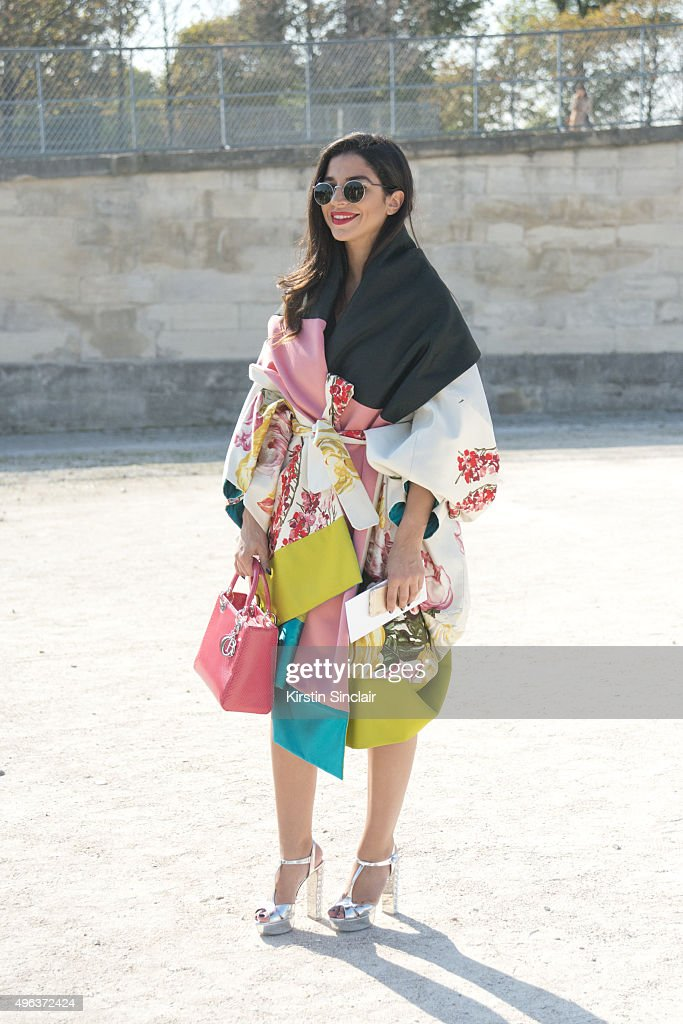 Marketing Consultant Souraya Chalhoub wears a Kenzo jacket Dior bag Miu Miu shoes and vintage sunglasses on day 5 during Paris Fashion Week...