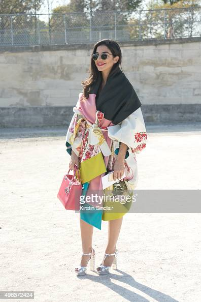 Marketing Consultant Souraya Chalhoub wears a Kenzo jacket Dior bag Miu Miu shoes and vintage sunglasses on day 5 during Paris Fashion Week...