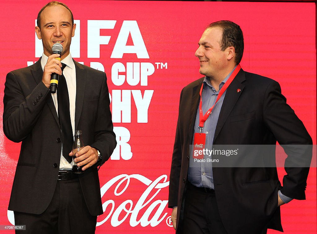 Marketing Director of Coca-Cola Italy Fabrizio Nucifora (L) and Director of Public Affairs & Communications of Coca-Cola Italy Vittorio Cino attend a party during day two of the FIFA World Cup Trophy Tour on February 20, 2014 in Rome, Italy.
