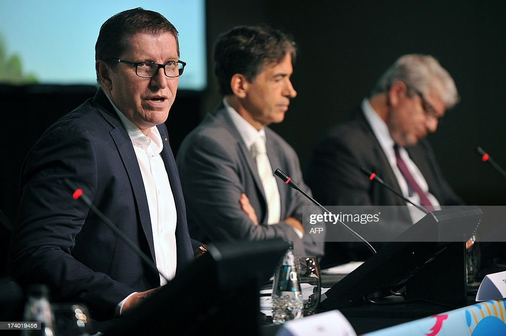 Marketing Director Thierry Weil (L) attends a press conference to announce the ticketing strategy for the 2014 FIFA World Cup on July 19, 2013, in Sao Paulo, Brazil.