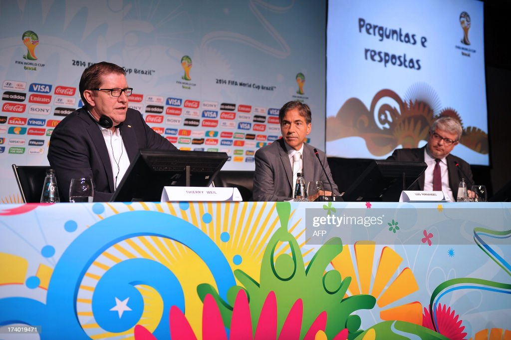 Marketing Director Thierry Weil (L) speaks during a press conference to announce the ticketing strategy for the 2014 FIFA World Cup on July 19, 2013, in Sao Paulo, Brazil.