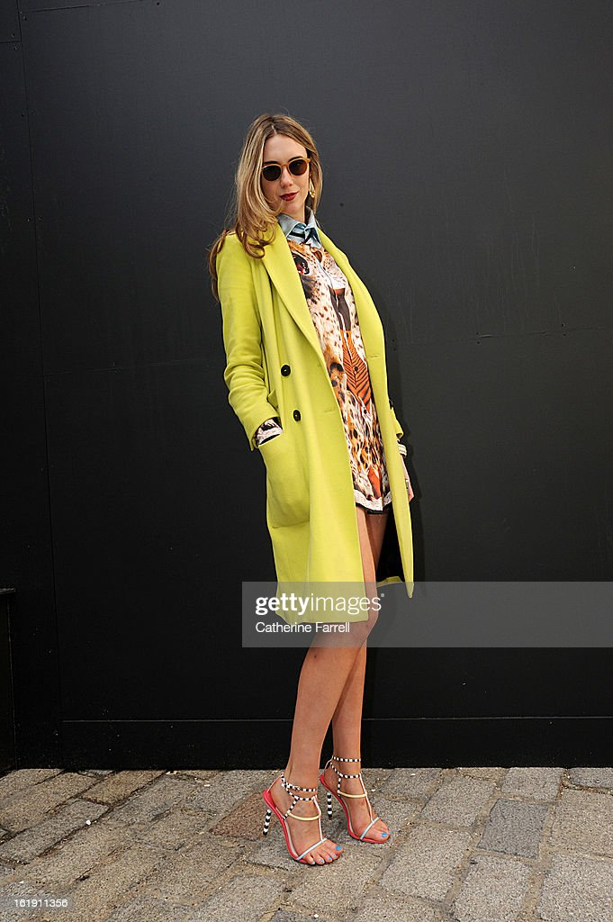 Marketing Editor at Net A Porter Jessica Hannon wears a Cecilia Hammarborg coat,Katie Eary top,micro mini PVC skirt from Sex shop in Paris,spagetti strap sandals from Royal College of Art graduate Sophia Webster's first collection, sunglasses borrowed from house mate, and Ibiza bangels, at London Fashion Week Fall/Winter 2013/14 on February 17, 2013 in London, England.