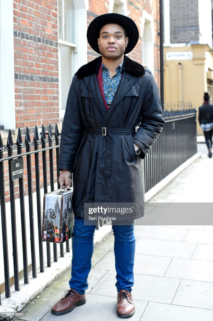 Marketing Exec Thomas (22) poses wearing a Vintage hat, jacket and blazer, Jennies shirt with H+M Shoes a TK Maxx briefcase and a Rotary watch at the Shaun Samson catwalk presentation during London Collection: MEN on January 9, 2013 in London, England.