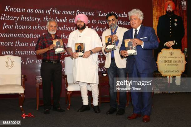Marketing Guru Suhel Seth Punjab Chief Minister Captain Amarinder Singh and writer Khushwant Singh during the launch of a book titled 'Captain...