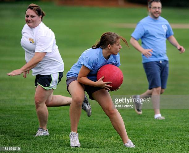 Marketing intern Jessica Lesser center fielded the ball during an Aspenware employees kickball game after work Tuesday afternoon July 17 2012...