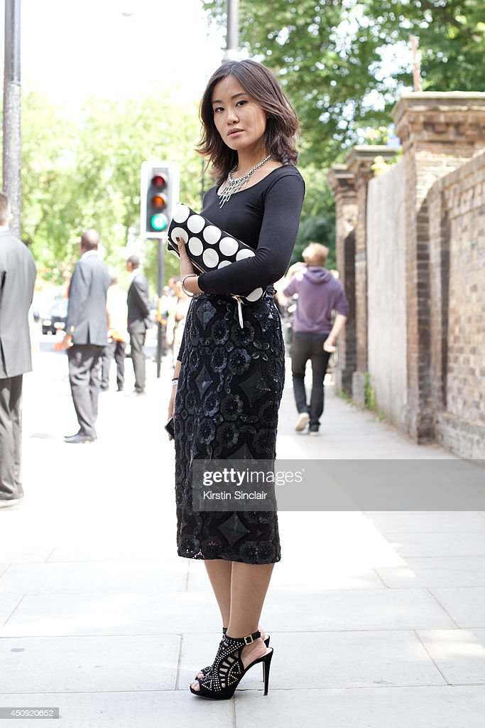 Marketing Manager Audrey Ling wears a Burberry skirt and bag, Zara top on day 3 of London Collections: Men on June 17, 2014 in London, England.