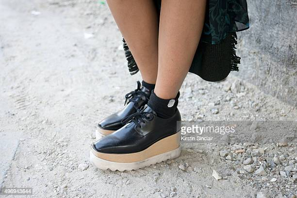 Marketing Manager for Kenzo Kuwait Sama Al Wasmi wears a Kenzo dress and Stella McCartney shoes on day 6 during Paris Fashion Week Spring/Summer...