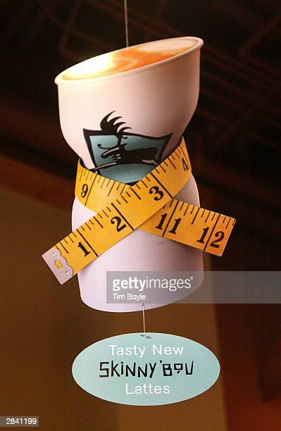 Marketing signage for new 'Skinny'Bou Lattes' hangs in a Caribou Coffee store January 2 2004 in Mount Prospect Illinois Caribou Coffee Company Inc...