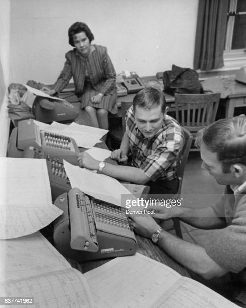 Marketing students Dick Frazier right and Don Pospahala tabulate results of grocery price survey directed by Dr Dorothy Sandham left Credit Denver...