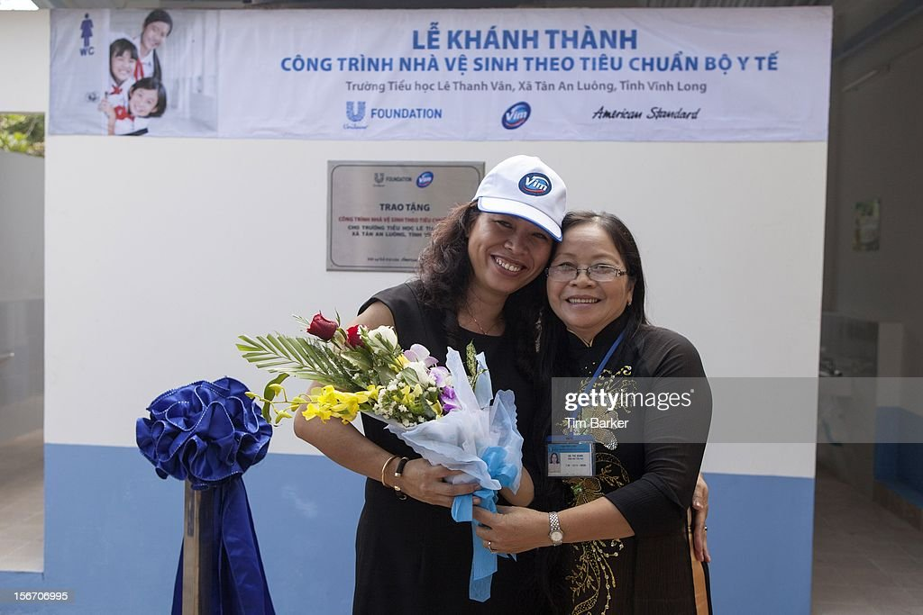 Marketing Vice President of Unilever Vietnam Nguyen Thi Bich Van and Principal of Le Thanh Van Primary School Ha Thi Dung pose at the inauguration of the new toilet complex at the Le Thanh Van Primary School on World Toilet Day on November 19, 2012 in Vinh Long, Vietnam.