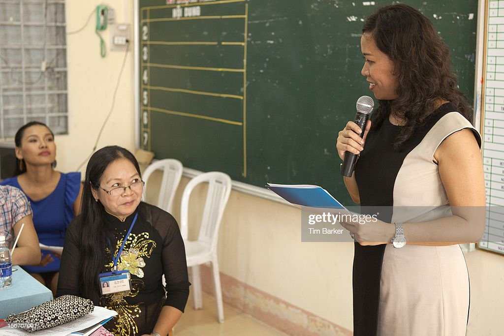 Marketing Vice President of Unilever Vietnam Nguyen Thi Bich Van speaks as Principal of Le Thanh Van Primary School Ha Thi Dung (L) looks on during the inauguration of the new toilet complex at the Le Thanh Van Primary School on World Toilet Day on November 19, 2012 in Vinh Long, Vietnam.