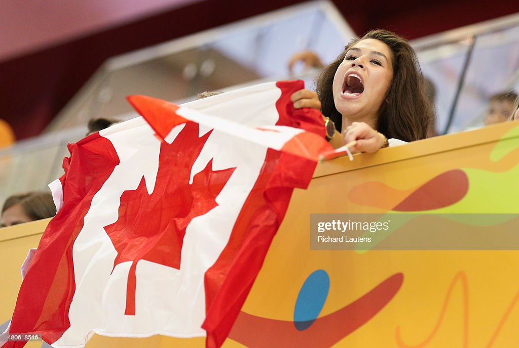 Markham, Canada - July, 13 2015 - A canadian fan shouts out her support early in the game. Canada lost to the USA in the Pan Am men's Water Polo semi-final 9-8 that was held at the Atos Markham Centre Monday night with the winner moving on to the gold medal match. Toronto2015 July 13, 2015