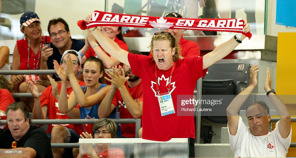 Markham, Canada - July, 13 2015 - Canada Chef de Mission, Curt Harnet tries to rally the crowd late in the game. Canada lost to the USA in the Pan Am men's Water Polo semi-final 9-8 that was held at the Atos Markham Centre Monday night with the winner moving on to the gold medal match. Toronto2015 July 13, 2015