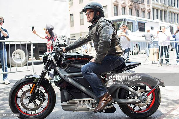 MarkHans Richer Harley Davidson's chief marketing officer rides a Harley Davidson Livewire motorcycle the company's first electric bike at a press...