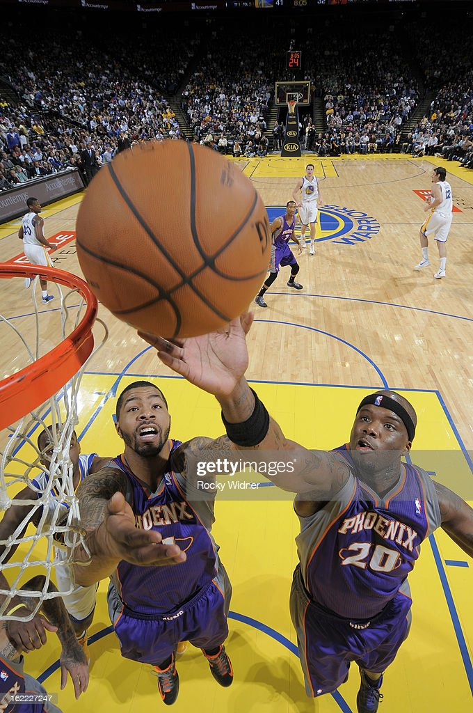 Markief Morris #11 and Jermaine O'Neal #20 of the Phoenix Suns rebound against the Golden State Warriors on February 20, 2013 at Oracle Arena in Oakland, California.