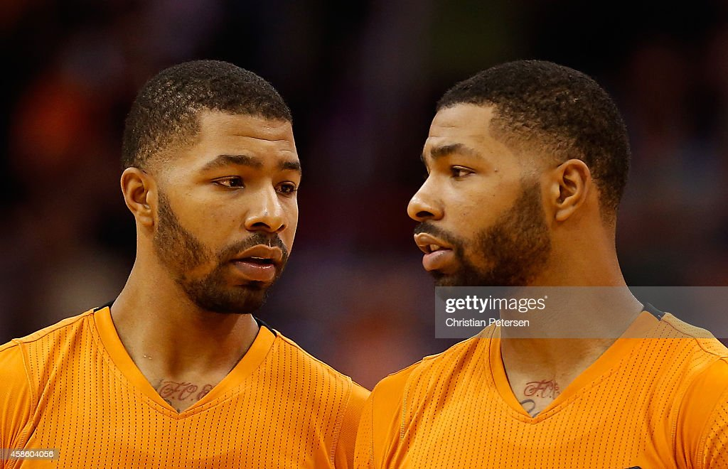 Markieff Morris and Marcus Morris of the Phoenix Suns await a free throw shot during the second half of the NBA game against the Sacramento Kings at...