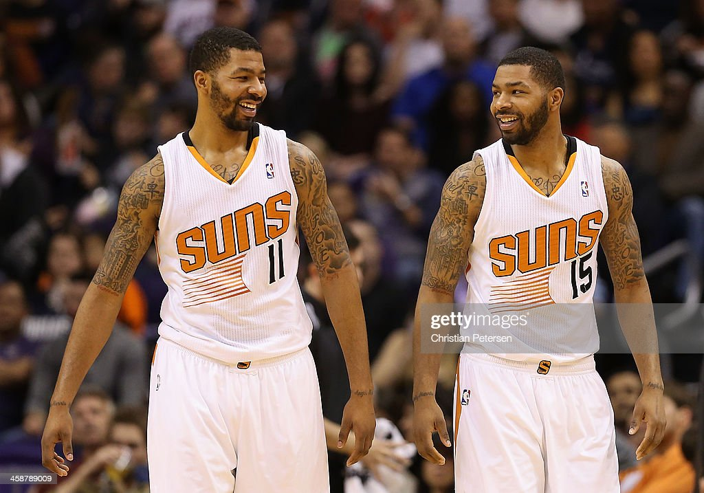 Markieff Morris and Marcus Morris of the Phoenix Suns react during the NBA game against the Dallas Mavericks at US Airways Center on December 21 2013...