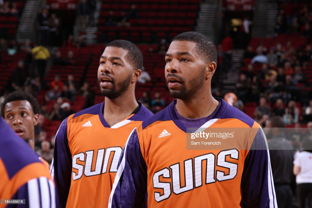 <a gi-track='captionPersonalityLinkClicked' href=/galleries/search?phrase=Markieff+Morris&family=editorial&specificpeople=5293881 ng-click='$event.stopPropagation()'>Markieff Morris</a> #11 and Marcus Morris #15 of the Phoenix Suns warm up before the game against the Portland Trail Blazers on October 9, 2013 at the Moda Center Arena in Portland, Oregon.