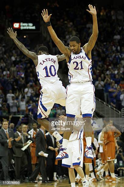 Markieff Morris and Tyshawn Taylor of the Kansas Jayhawks celebrate after a play against the Texas Longhorns in the first half of the 2011 Phillips...