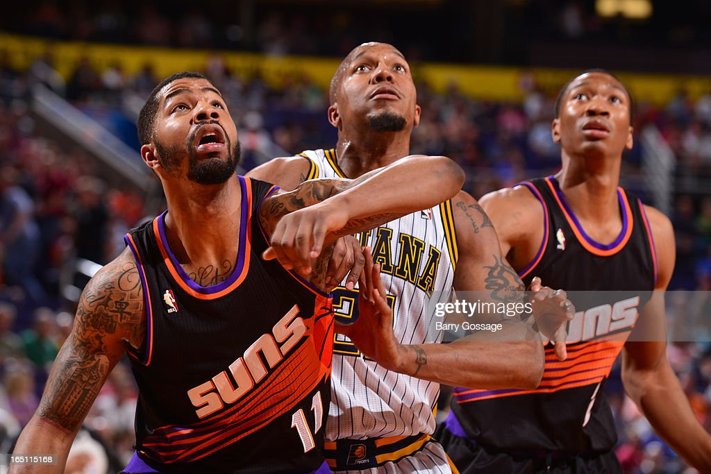 Markieff Morris #11 and Wesley Johnson #2 of the Phoenix Suns battle for position with David West #21 of the Indiana Pacers on March 30, 2013 at U.S. Airways Center in Phoenix, Arizona.