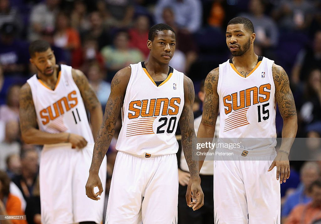 Markieff Morris #11, Archie Goodwin #20 and Marcus Morris #15 of the Phoenix Suns during the NBA game against the Sacramento Kings at US Airways Center on November 20, 2013 in Phoenix, Arizona.