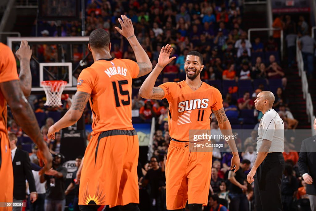 Markieff Morris high fives Marcus Morris of the Phoenix Suns during the game against the Atlanta Hawks at US Airways Center in Phoenix Arizona NOTE...