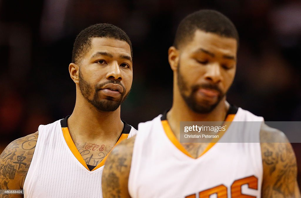 Markieff Morris oand Marcus Morris of the Phoenix Suns during the NBA game against the Indiana Pacers at US Airways Center on December 2 2014 in...
