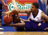 Markieff Morris of the Kansas Jayhawks battles Terrell Barnes of the Tennessee Tech Golden Eagles for a loose ball during the game on November 27...
