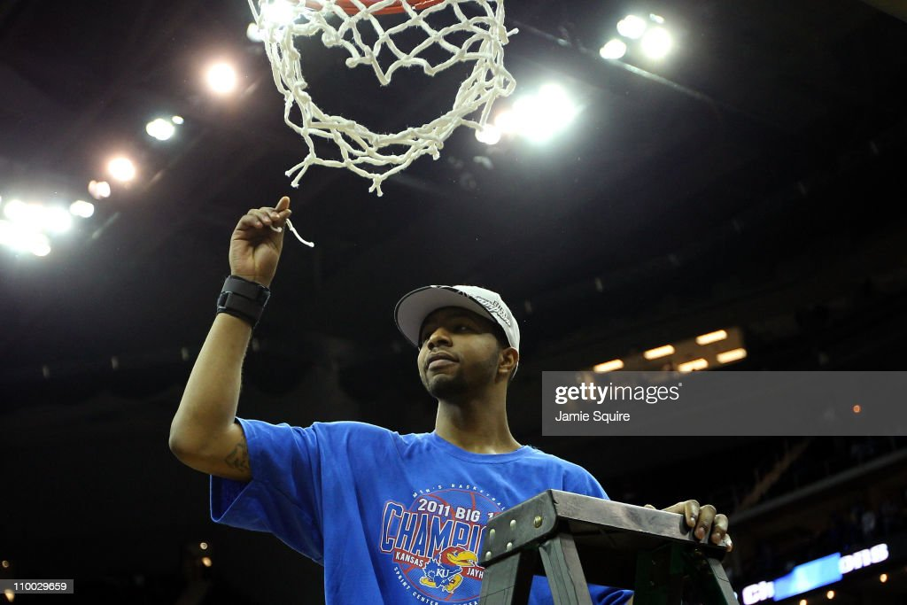 Markieff Morris of the Kansas Jayhawks celebrates by cutting down the net after defeating the Texas Longhorns 8573 to win the 2011 Phillips 66 Big 12...