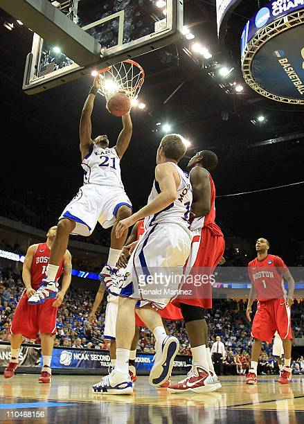 Markieff Morris of the Kansas Jayhawks dunks the ball against the Boston University Terriers during the second round of the 2011 NCAA men's...