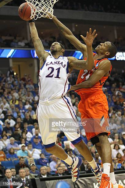 Markieff Morris of the Kansas Jayhawks goes up for a shot against Mike Davis of the Illinois Fighting Illini during the third round of the 2011 NCAA...