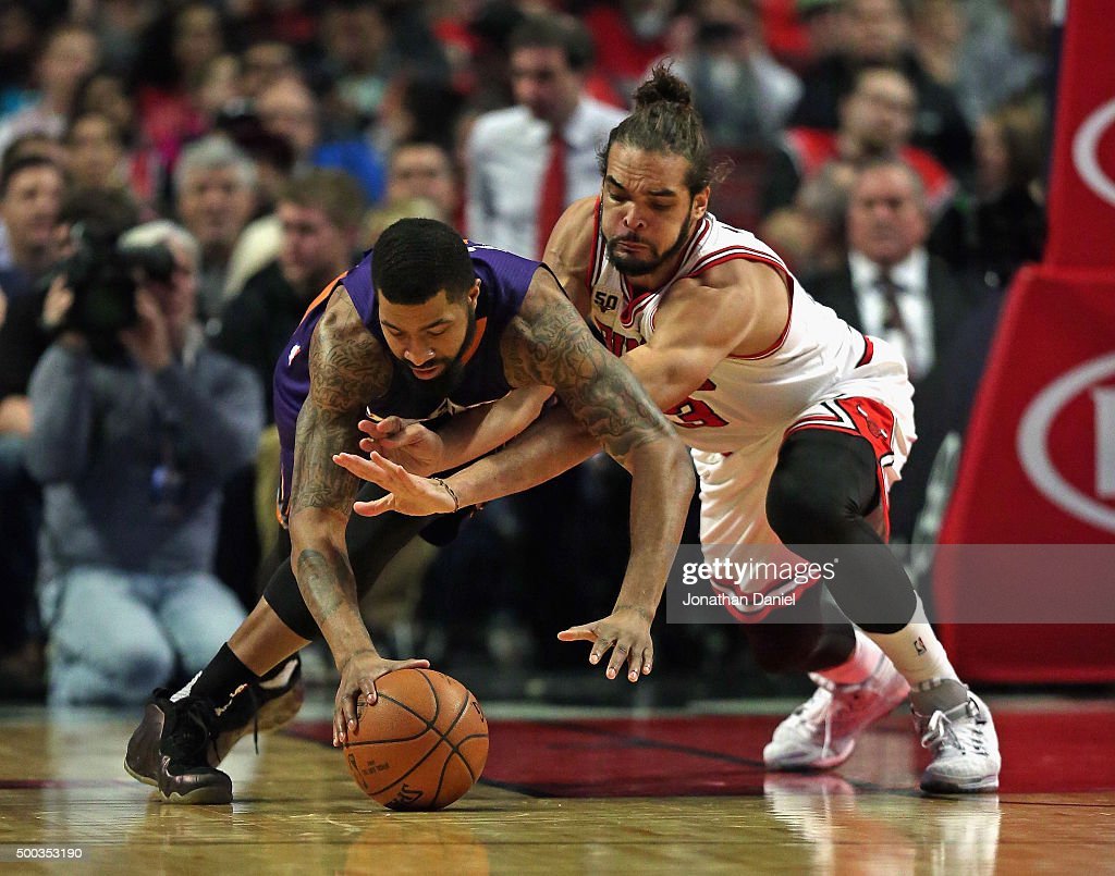 Markieff Morris of the Phoenix Suns and Joakim Noah of the Chicago Bulls battle for a loose ball at the United Center on December 7 2015 in Chicago...