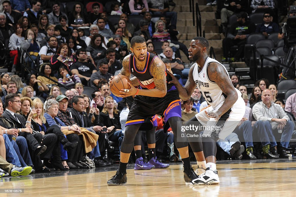<a gi-track='captionPersonalityLinkClicked' href=/galleries/search?phrase=Markieff+Morris&family=editorial&specificpeople=5293881 ng-click='$event.stopPropagation()'>Markieff Morris</a> #11 of the Phoenix Suns controls the ball against <a gi-track='captionPersonalityLinkClicked' href=/galleries/search?phrase=DeJuan+Blair&family=editorial&specificpeople=4649451 ng-click='$event.stopPropagation()'>DeJuan Blair</a> #45 of the San Antonio Spurs on February 27, 2013 at the AT&T Center in San Antonio, Texas.