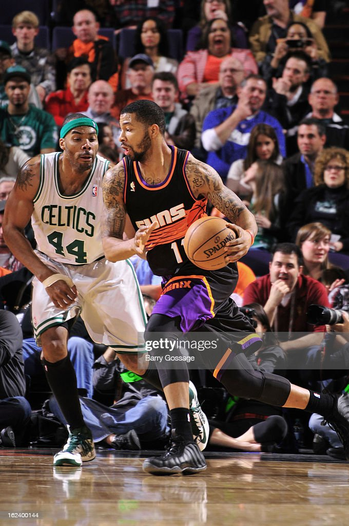 <a gi-track='captionPersonalityLinkClicked' href=/galleries/search?phrase=Markieff+Morris&family=editorial&specificpeople=5293881 ng-click='$event.stopPropagation()'>Markieff Morris</a> #11 of the Phoenix Suns drives against <a gi-track='captionPersonalityLinkClicked' href=/galleries/search?phrase=Chris+Wilcox&family=editorial&specificpeople=202038 ng-click='$event.stopPropagation()'>Chris Wilcox</a> #44 of the Boston Celtics on February 22, 2013 at U.S. Airways Center in Phoenix, Arizona.