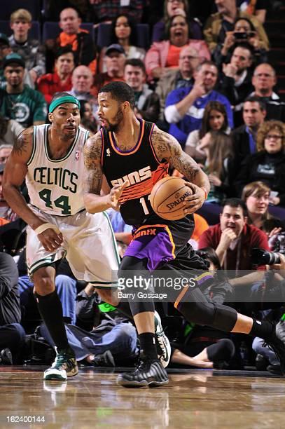 Markieff Morris of the Phoenix Suns drives against Chris Wilcox of the Boston Celtics on February 22 2013 at US Airways Center in Phoenix Arizona...