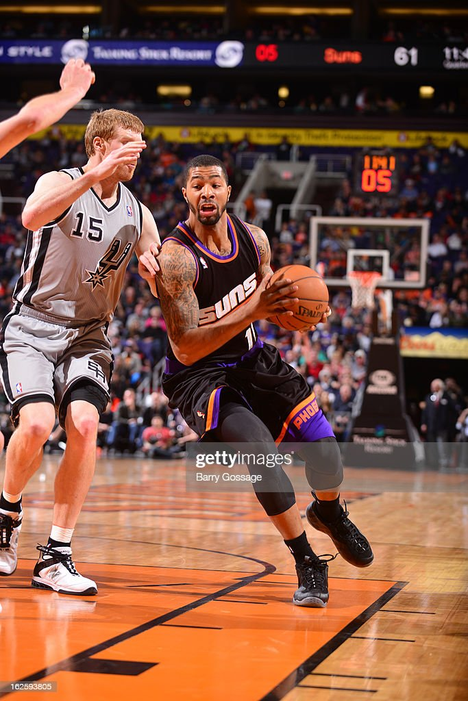<a gi-track='captionPersonalityLinkClicked' href=/galleries/search?phrase=Markieff+Morris&family=editorial&specificpeople=5293881 ng-click='$event.stopPropagation()'>Markieff Morris</a> #11 of the Phoenix Suns drives against <a gi-track='captionPersonalityLinkClicked' href=/galleries/search?phrase=Matt+Bonner&family=editorial&specificpeople=203054 ng-click='$event.stopPropagation()'>Matt Bonner</a> #15 of the San Antonio Spurs on February 24, 2013 at U.S. Airways Center in Phoenix, Arizona.