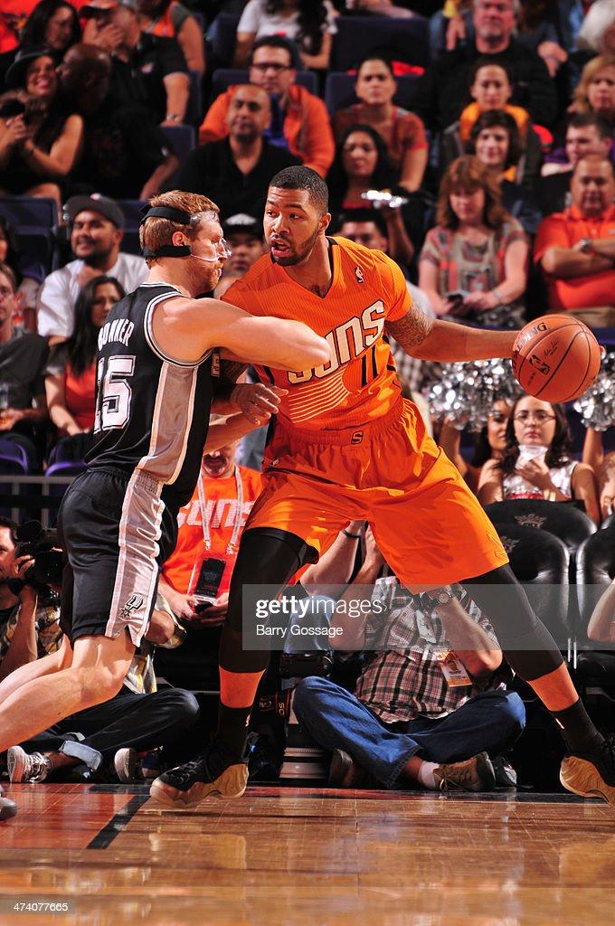 Markieff Morris #11 of the Phoenix Suns drives against Matt Bonner #15 of the San Antonio Spurs on February 21, 2014 at U.S. Airways Center in Phoenix, Arizona.