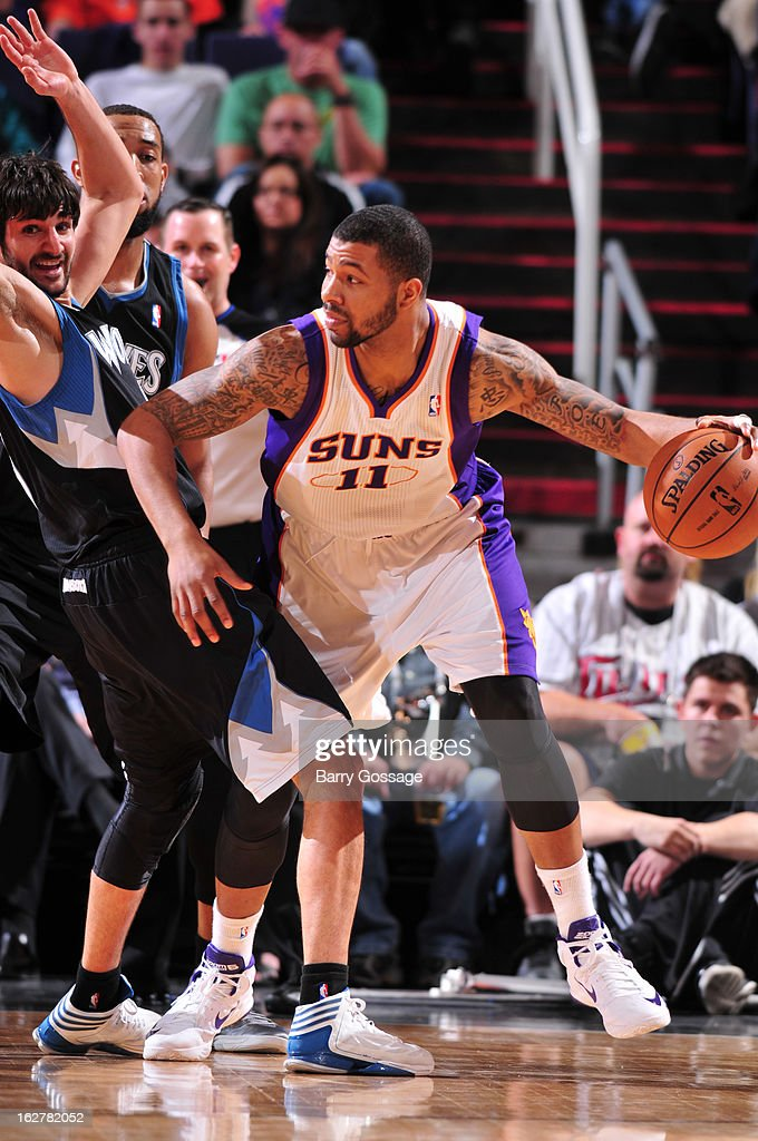 <a gi-track='captionPersonalityLinkClicked' href=/galleries/search?phrase=Markieff+Morris&family=editorial&specificpeople=5293881 ng-click='$event.stopPropagation()'>Markieff Morris</a> #11 of the Phoenix Suns drives against <a gi-track='captionPersonalityLinkClicked' href=/galleries/search?phrase=Ricky+Rubio&family=editorial&specificpeople=4028920 ng-click='$event.stopPropagation()'>Ricky Rubio</a> #9 of the Minnesota Timberwolves on February 26, 2013 at U.S. Airways Center in Phoenix, Arizona.