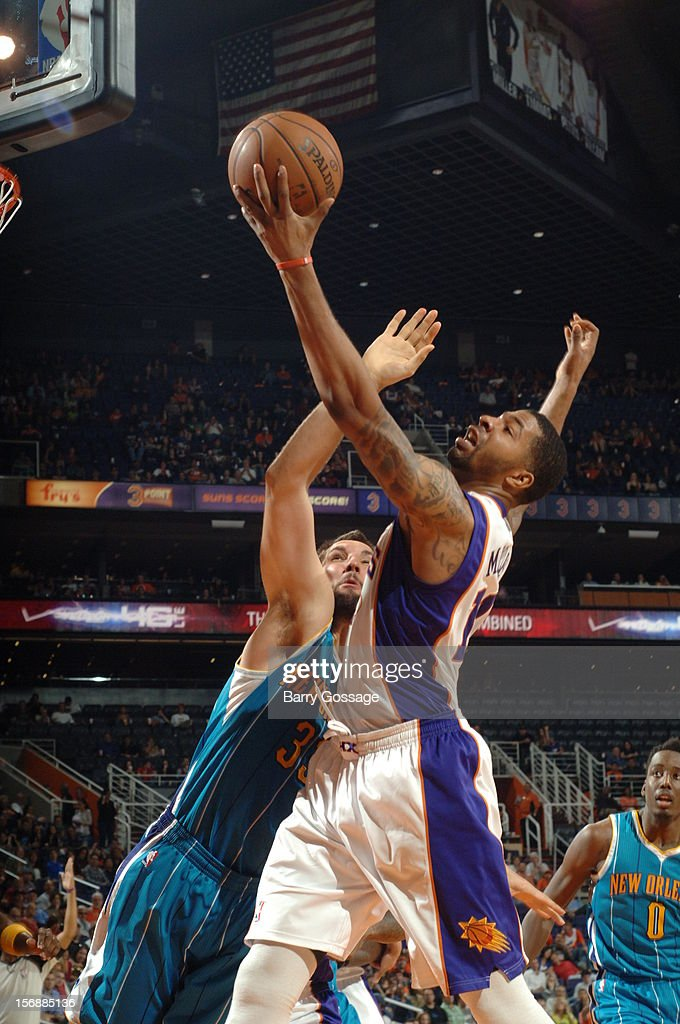 <a gi-track='captionPersonalityLinkClicked' href=/galleries/search?phrase=Markieff+Morris&family=editorial&specificpeople=5293881 ng-click='$event.stopPropagation()'>Markieff Morris</a> #11 of the Phoenix Suns drives for a shot against Ryan Anderson #33 of the New Orleans Hornets on November 23, 2012 at U.S. Airways Center in Phoenix, Arizona.