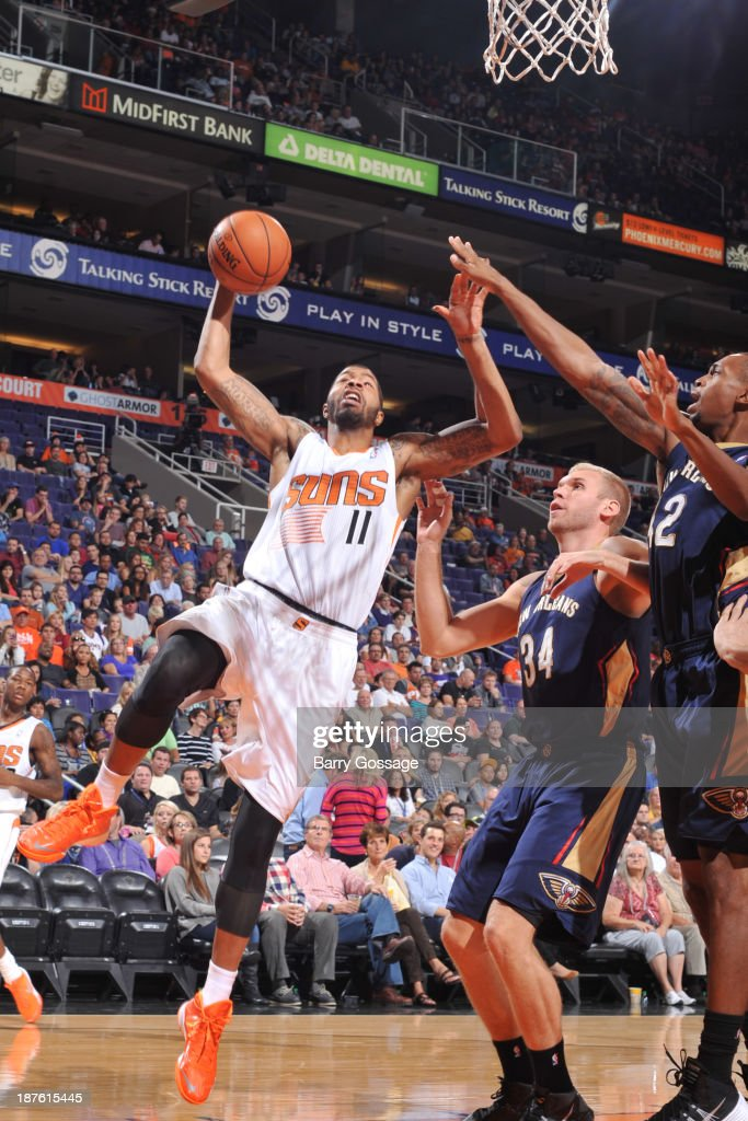Markieff Morris #11 of the Phoenix Suns drives for a shot past Greg Stiemsma #34 and Lance Thomas #42 of the New Orleans Pelicans on November 10, 2013 at U.S. Airways Center in Phoenix, Arizona.