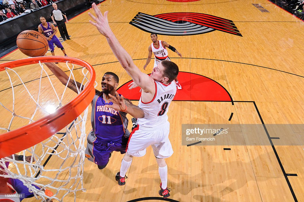 <a gi-track='captionPersonalityLinkClicked' href=/galleries/search?phrase=Markieff+Morris&family=editorial&specificpeople=5293881 ng-click='$event.stopPropagation()'>Markieff Morris</a> #11 of the Phoenix Suns drives to the basket against <a gi-track='captionPersonalityLinkClicked' href=/galleries/search?phrase=Luke+Babbitt&family=editorial&specificpeople=5122155 ng-click='$event.stopPropagation()'>Luke Babbitt</a> #8 of the Portland Trail Blazers on December 22, 2012 at the Rose Garden Arena in Portland, Oregon.