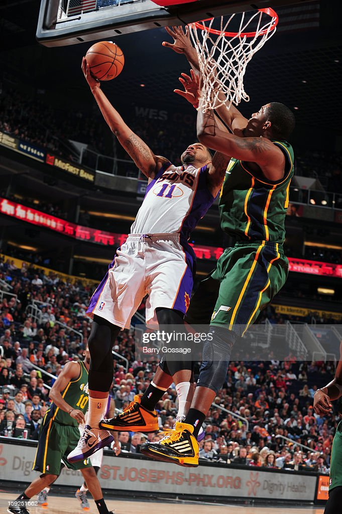 Markieff Morris #11 of the Phoenix Suns drives to the basket against the Utah Jazz on January 4, 2013 at U.S. Airways Center in Phoenix, Arizona.