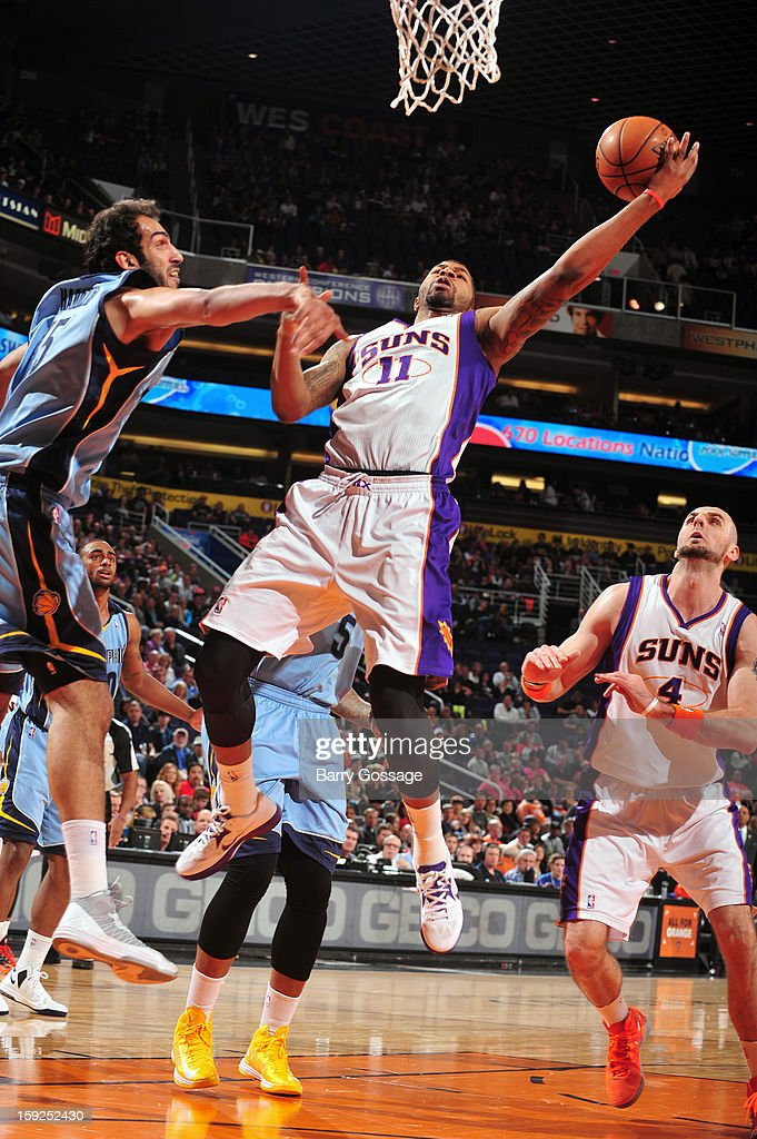 <a gi-track='captionPersonalityLinkClicked' href=/galleries/search?phrase=Markieff+Morris&family=editorial&specificpeople=5293881 ng-click='$event.stopPropagation()'>Markieff Morris</a> #11 of the Phoenix Suns drives to the basket against the Memphis Grizzlies on January 6, 2013 at U.S. Airways Center in Phoenix, Arizona.