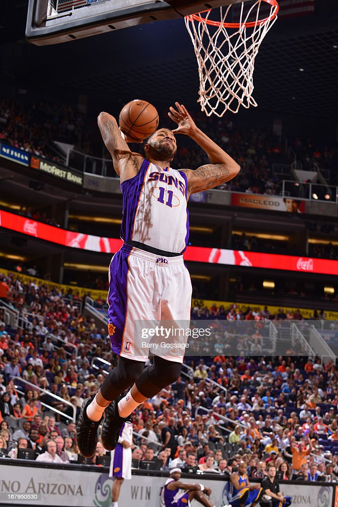 <a gi-track='captionPersonalityLinkClicked' href=/galleries/search?phrase=Markieff+Morris&family=editorial&specificpeople=5293881 ng-click='$event.stopPropagation()'>Markieff Morris</a> #11 of the Phoenix Suns drives to the basket against the Golden State Warriors on April 5, 2013 at U.S. Airways Center in Phoenix, Arizona.