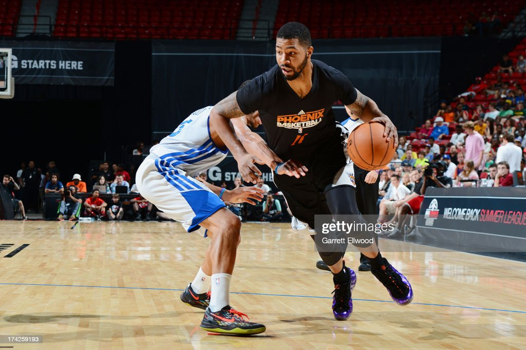 <a gi-track='captionPersonalityLinkClicked' href=/galleries/search?phrase=Markieff+Morris&family=editorial&specificpeople=5293881 ng-click='$event.stopPropagation()'>Markieff Morris</a> #11 of the Phoenix Suns drives to the basket against the Golden State Warriors during NBA Summer League Championship Game on July 22, 2013 at the Cox Pavilion in Las Vegas, Nevada.