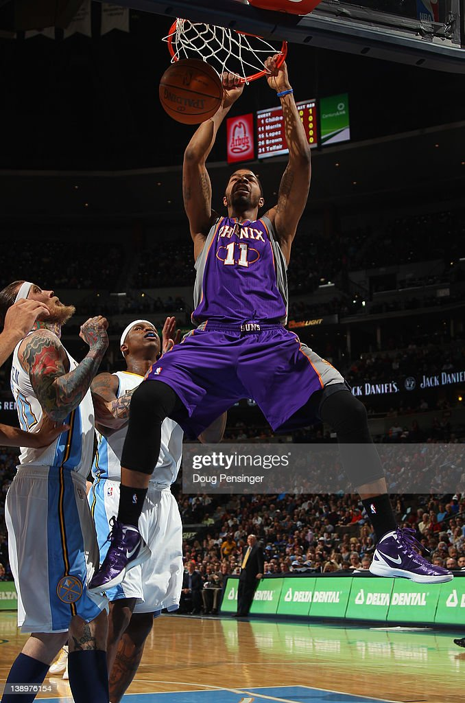 Markieff Morris of the Phoenix Suns dunks the ball against Chris Andersen and Al Harrington of the Denver Nuggets at the Pepsi Center on February 14...