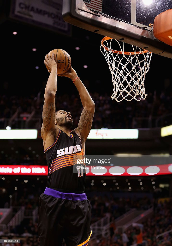 <a gi-track='captionPersonalityLinkClicked' href=/galleries/search?phrase=Markieff+Morris&family=editorial&specificpeople=5293881 ng-click='$event.stopPropagation()'>Markieff Morris</a> #11 of the Phoenix Suns goes up for a slam dunk against the Boston Celtics during the NBA game at US Airways Center on February 22, 2013 in Phoenix, Arizona. The Celtics defeated the Suns 113-88.